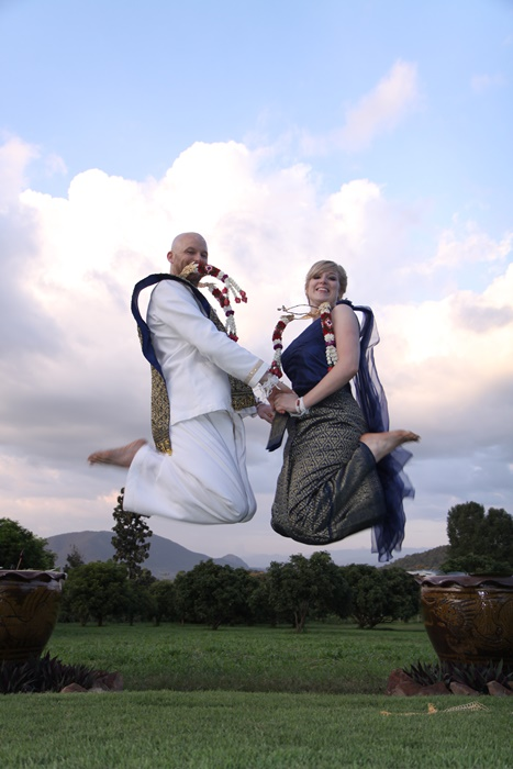 couples jumping for joy after getting legally married in Chiang MAi.